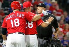 Mitch Moreland and manager Jeff Banister argue with home plate umpire Kerwin Danley after Moreland was ejected after arguing a called third strike during the Angels vs. Rangers game on Monday, September 19, 2016. (Louis DeLuca/The Dallas Morning News)