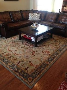 Pottery Barn Eva Rug 9 x 12. It looks good with the brown leather sofa.