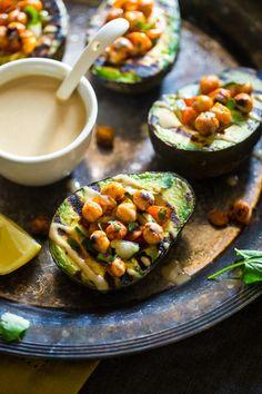Mediterranean Grilled Avocado Stuffed with Chickpeas and Tahini {Vegan + Gluten Free} via @FoodFaithFit