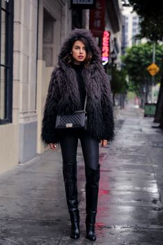 fur coat with skinny jeans and boots