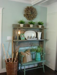 What a beautiful little idea. A mantle in the entry way with a little bench under.