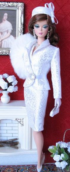 Barbie in white satin suit - lots of gorgeous OOAK Barbies on this site.
