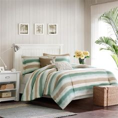 "Create a calming environment in your bedroom with the Harbor House Sea Escape Bedding Collection. The soft sea green mixes with sand and khaki shades are printed in horizontal stripes on 250 thread count cotton. This tranquil collection includes a 1"" flange on the shams for a finished, tailored look."