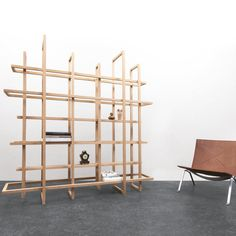 Check this out: Frames 2.0: A Bookcase or a Room Divider. https://re.dwnld.me/D63M-frames-2-0-a-bookcase-or-a-room-divider