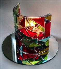 """Approximately 5"""" high.  Reds, greens, amber, and just a tiny touch of purple.  Fused 90 COE glass, bent over a half pipe for a perfect curve.  This pieces is currently at Waupaca Community Artists Co-op. - See this image on Photobucket."""