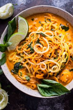 """This vegan Thai lemongrass coconut curry soup is a light and fresh soup with spiralized sweet potato, zucchini, and celery root vegetable """"noodles""""."""