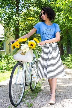 Off to the farmers market you go—and anywhere else your errands take you—on a sweet retro cruiser bike. Featured product includes: typographic T-shirt, ELLE striped midi skirt, Candie's lace-up Ghillie flats, Schwinn Wayfarer bike and Nantucket bicycle basket. Find your summer style at Kohl's.