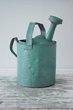 A turquoise galvanized watering can