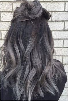 Look At This Beauty with Silver Bullet on top of high-lighted Brunette Hair