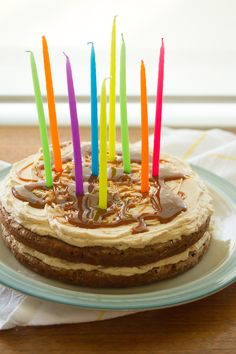 Layers of chai-scented banana cake are stacked with a sweet brown sugar buttercream and a drizzle of dulce de leche for an easy (yet impressive) party cake.
