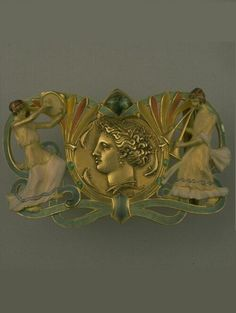 'Syracuse' buckle, by Eugène Grasset (designer) and Maison Vever (Paul and Henry - jewellers), circa 1900, Paris, composed of enamel, gold and emerald.