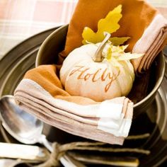 How to Throw a Fall Harvest Party --> lots of cozy ideas, love the personalized mini pumpkin place setting! via The Local Honey #Thanksgiving #party