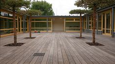 Educational Architecture and School Building Design Education Architecture, Architecture Office, Architecture Design, Wood Deck Designs, School Building Design, Wooden Terrace, Outdoor Seating Areas, Outdoor Landscaping, Sustainable Design