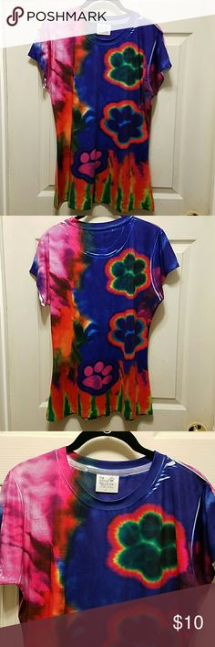 NWOT~ TIE-DYE TEE 💞🐾💞 WOW & HOLY PAW PRINT 🐾 does this have a lot going on❣  Ok, this shirt is adorable...just sayin!🙃 You've got tie-dye, sublimation & paw prints galore!😍  I received this for making a donation to the animal rescue site so I don't have a monetary value for this shirt.  87% polyester 13% spandex.  That soft, stretchy spandexy material so it's not your everyday cotton tee you animal lovers.🐶🐱  NWOT~ it's just been in my drawer.  I have lots of 'I love 💖 my dog' tees…