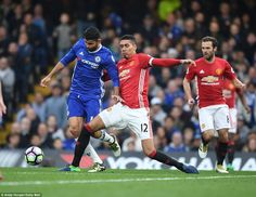 Chelsea's Diego Costa (left) is challenged by Manchester United's Chris Smalling as Juan Mata looks on