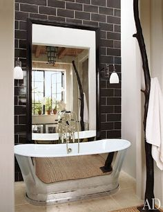 source: Architectural Digest Alfredo Paredes - Waterworks Candide Tub, charcoal gray subway tiles backsplash accent wall and glossy black beveled mirror. Love the black subway tiles for my kitchen! House Design, House, Classic Bathroom, City Apartment, Small Bathroom, Bathroom Design, Beautiful Bathrooms, Architectural Digest, New York Apartment