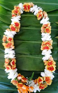 This is a gorgeous double ilima and tuberose lei.  It looks so beautiful and smells sooooo goood!  Two shades of orange in the ilima flower with the bright white and wonderful fragrance of the tuberose.  We can ship this to you in two days to anywhere in the USA straight from Hawaii!  www.alohahawaiianflowers.com