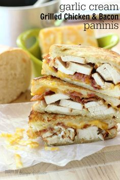 Garlic Cream Grilled Chicken & Bacon Paninis - Thin slices of grilled chicken, crispy bacon, and Colby Jack cheese piled onto sliced loaf bread spread with a garlic cream sauce and grilled until golden brown.