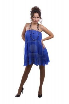 Fashion woman wearing blue dress on the white background. Gorgeous model is in fashion and posing.
