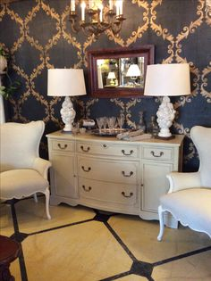 Fabulous pair of vintage chairs Newly upholstered in designer fabric flanking a vintage chest painted in Annie Sloan Chalk Paint®