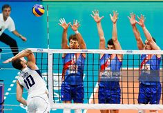 Filippo Lanza (L) of Italy spikes the ball during the match between Serbia and Italy at Maracanazinho Gymnasium during day one of the FIVB World League 2015 Group 1 Final, on July 15, 2015 in Rio de Janeiro, Brazil.
