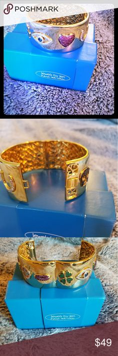 """""""Love, Luck&Strength"""" CZ Goldtone Hinged Bangle Jewels by Jen """"Love, Luck and Strength"""" CZ Goldtone Pavé Symbol Hinged Bangle Bracelet Measurements: Approx. 7""""L x 1/4""""W; fits 5-3/4"""" to 6-3/4"""" wrist Metal Color: Goldtone Findings: Snap lock closure Finish: Polished, Finished underside, hinged back Comes in original packaging, boxed  Total Carat Weight: 3.69ct NIB Jewels by Jen Jewelry Bracelets"""