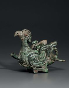 A rare small bronze phoenix-form ewer, China, Late Western-Early Eastern Zhou Dynasty, 8th-7th century BC