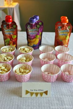 What a great idea! Set out small cups and squeeze pouches of food for the really little ones. | Lindsay's Sweet World: Pink and gold first birthday party