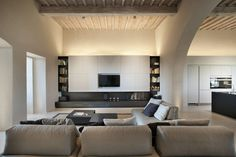 This Tuscan Farm Villa Is the Perfect Retreat From the World: Bridging together vintage restoration with modern day design cues. Villas, Farm Villa, Living Area, Living Spaces, Bookshelves In Bedroom, Wood Interior Design, Residential Lighting, Italian Villa, Living Room Storage