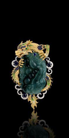 Brooch 11461 Collection: Mysticism  18K yellow and white gold, jadeite 46,35 ct, diamonds, black diamonds, green diamonds, blue sapphires, tsavorite, demantoid.  Set:  Ring 11827