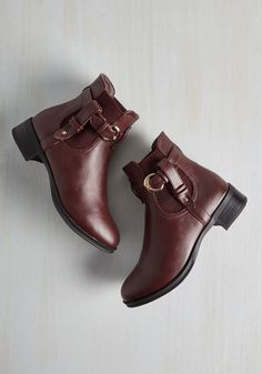 Impressed for Time Bootie. Even when rushing around, you manage to dazzle packs of passersby with these burgundy booties! #red #modcloth