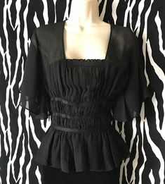 Made of flowing Silk, this Black Silk Express Top has a thoughtful shirring that accentuates bosom and waist…. Vintage Designer Clothing, Summer Blouses, Black Silk, Silk Top, Black Tops, Vintage Outfits, Ruffle Blouse, Romantic, Women