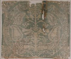 8th or 9th c silk samite from Egypt or Syria; the Norse cut silk samite fabric into thin strips & appliqued it as trim onto clothing
