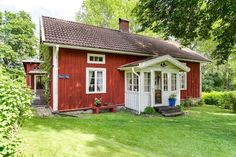 images of swedish red cottages   The typical Swedish idyllic red little cottage covered with a water ...