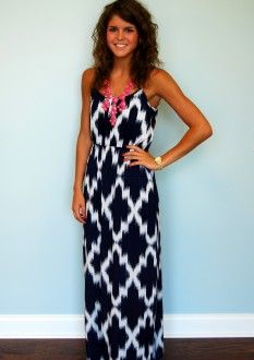 Long, patterned dress, with colorful bubble necklace.