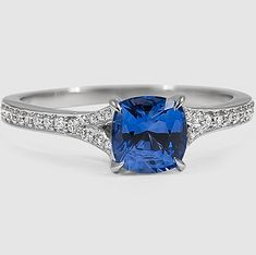 A cushion blue sapphire sits beautifully in the Duet Diamond Ring.