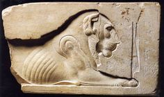 Egyptian limestone relief fragment, Egyptian, 30th Dynasty-early Ptolemaic Period, 380-200 B.C. Depicting a crouching lion, 10 x 18 cm. Private collection