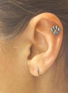 Animal Paw Print Cartilage Earring Helix Piercing by MidnightsMojo. A paw print that doesn't look childish or cartoony.