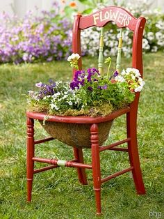 Repurpose an old chair and use it in the garden to hold your blooming flowers.