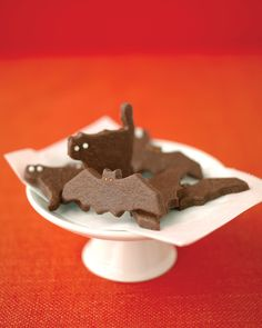 Halloween Cookies | Martha Stewart Living - Start a new Halloween tradition: Bake chocolate cookies cut into the shapes of ghostly bats and cats.