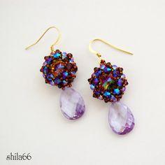 Swarovski Disk Earrings Lilac by Shila66. Smoked topaz ab2x bicones and topaz purple haze rivolis?