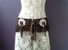 SUEDE HIP BELT, fringed belt, brown leather belt, bohemian belt, festival belt   A unique suede hip belt.  Brown quality cow hide, She is fringed with crochet doilies and copper conchos.  2 D rings at the ends with long suede ties !   36 inches wide along the waist band .. 92 cm  7 inches long in the middle .. 18 cm  4 1/2 long at the ends .. 11 cm   Curved to sit nicely on the hip or waist, she can be worn front or side.  Festival fashion, a great accessory to your boho wardrobe.!  Tha...