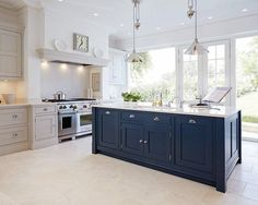 Georgian pane doors - large panes of glass either side Blue Painted Kitchen - Bespoke Kitchens - Tom Howley.because who wouldn't want to have a blue kitchen island? Kitchen Paint, Living Room Kitchen, Open Plan Kitchen, New Kitchen, Shaker Kitchen, Kitchen Grey, Kitchen Units, Kitchen With Range Cooker, Hague Blue Kitchen