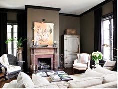 Black trim with dark walls - looks great, but you'd have to have light furnishings i think...