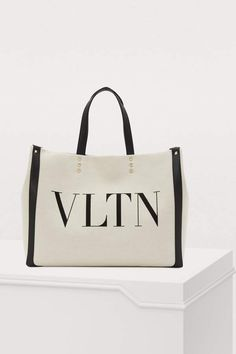 Buy Valentino Valentino Gavarani VLTN tote bag online on 24 Sèvres. Shop the latest trends - Express delivery & free returns Valentino Women, Valentino Shoes, Tote Bags Online, Classic Handbags, Purses And Handbags, Fashion Bags, Crossbody Bag, Leather, Designer Tote Bags