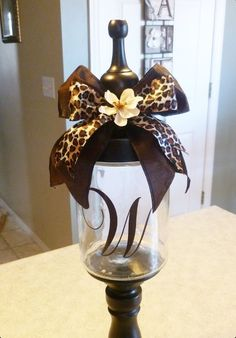 DIY: candy jar using an old glass jar and lid and a candle holder base...love it!!