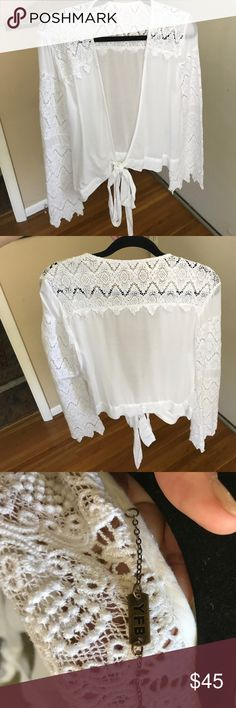 Free people lace wrap top size S Worn once, excellent condition Free People Tops Blouses