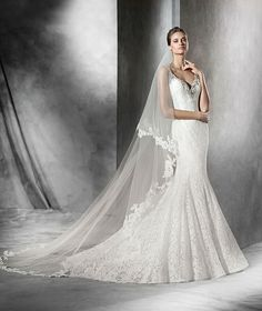 The New Design Wedding dress, lace mermaid dress. Bodice with straps and neckline decorated with lace and gemstones with V-neckline front and back.  Free Measurement