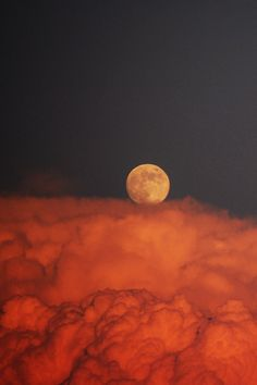 Moon...& I believe the red clouds are a dust storm
