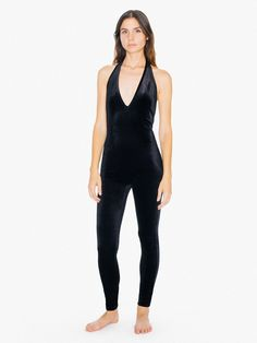 A form-fitting silhouette constructed from stretch velvet for a soft, touchable feel and long-wearing comfort. The Velvet Halter Catsuit features a halter strap, deep V neckline, low open back, and tapered legs. This catsuit wears true to size with easy stretch.
